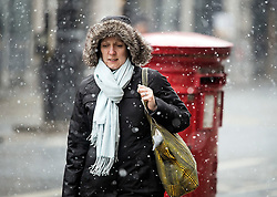 © Licensed to London News Pictures. 17/03/2018. London, UK. Snowfall on Oxford Street in central London as a 'Mini Beast' forecast to bring snow and ice the parts of the UK. The drop in temperatures is expected to bring disruption, with flights cancelled at Heathrow airport. . Photo credit: Ben Cawthra/LNP