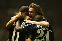 MANCHESTER, ENGLAND - Wednesday, April 23, 2003: Real Madrid's Ronaldo celebrates his hat-trick goal against Manchester United with Steve McManaman (r) and Claude Makelele during the UEFA Champions League Quarter Final 2nd Leg match at Old Trafford. (Pic by David Rawcliffe/Propaganda)