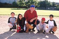 Coach with baseball team --- Image by © Jim Cummins/CORBIS