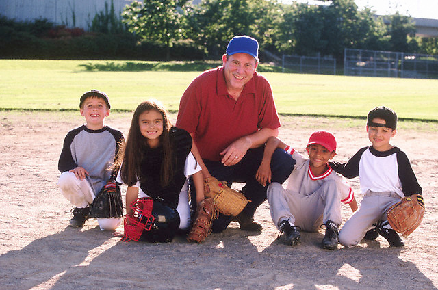 Coach with baseball team --- Image by © Jim Cummins/CORBIS