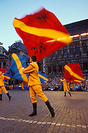 "Europe, Belgium, Brussels, participants of the Ommegang festival at the Grand Place, flag-waver [The Ommegang was originally established to commemorate the transfer of the miraculous statue of ""Notre-Dame sur la Branche"", who was worshipped in the Antwerp Cathedral. Over the years this commemorative procession has lost its religious character and has become a parade whose aim is to show the different reliquaries of Brussels. Nowadays the parade of the Ommegang is one of the most awe-inspiring spectacles in Belgium. It recalls the pomp and ceremony of a splendid celebration held there to honour Charles V and his Court (16th century). It is a celebration of grand proportions, complete with the costumes of the times and where the descendants of the nobility play the roles of their ancestors].....Europa, Belgien, Bruessel, Teilnehmer des Ommegang auf dem Grand Place, Fahnenschwenker [der Ommegang wurde urspruenglich ins Leben gerufen, um der Ueberfuehrung der wunderbaren Statue Notre Dame sur la Branche zu gedenken, die damals in der Kathedrale von Antwerpen verehrt wurde. Die Gedenkprozession verlor nach und nach ihren religioesen Charakter und wurde mit der Zeit ein prunkvolles Defilee um den Reichtum der Bruesseler zur Schau zu stellen...Heutzutage ist der Ommegang eine der grandiosesten historischen Darstellungen Belgiens. Die Veranstaltung stellt den Prunk eines im 16. Jh. zu Ehren des Karls V. und seines Hofes abgehaltenen Festes dar. Der Ommegang bleibt bis heute ein Fest voller Pracht mit historischen Kostuemen aus der damaligen Zeit und mit Nachkommen des Adels, die bestimmte Rollen einnehmen]..."