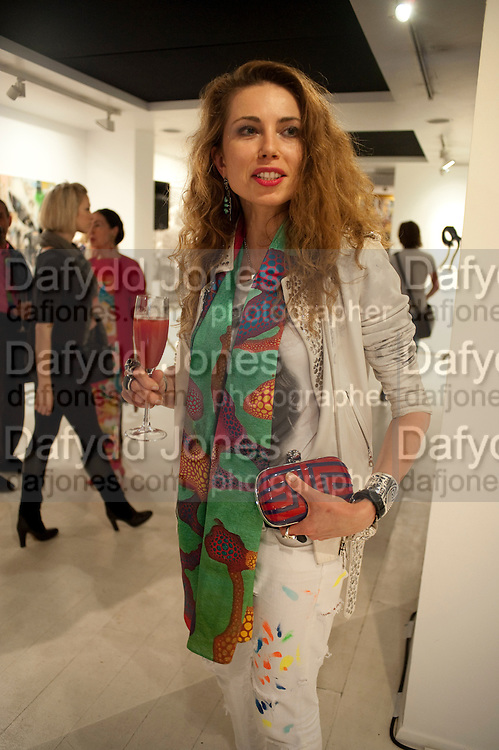 MALGOSIA STEPNIK, Private view and Summer party for Scream Now. An exhibitio of new work by gallery artists. Bruce French,, Derrick Santini, Greg Miller, Malgosia Stepnik, Pakpoom Silaphan, Petroc Sesti, Russell Young. Scream. Bruton st. London. 4 August 2011. <br /> <br />  , -DO NOT ARCHIVE-© Copyright Photograph by Dafydd Jones. 248 Clapham Rd. London SW9 0PZ. Tel 0207 820 0771. www.dafjones.com.