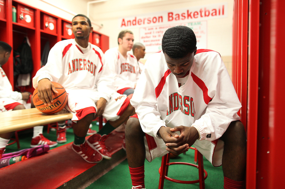 Chris Lemon has a quiet moment to himself in the Anderson High School locker room before a game in Anderson, Ind. This is the first season the team is playing in the new gym..Photo by Chris Bergin