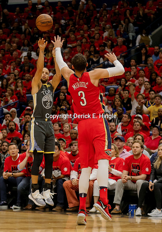 May 4, 2018; New Orleans, LA, USA; Golden State Warriors guard Stephen Curry (30) shoots over New Orleans Pelicans forward Nikola Mirotic (3) during the second quarter in game three of the second round of the 2018 NBA Playoffs at Smoothie King Center. The Pelicans defeated the Warriors 119-100.  Mandatory Credit: Derick E. Hingle-USA TODAY Sports