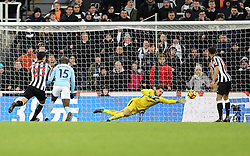 Manchester City goalkeeper Ederson (centre) dives as a header from Newcastle United's Dwight Gayle (not pictured) goes wide during the Premier League match at St James' Park, Newcastle.