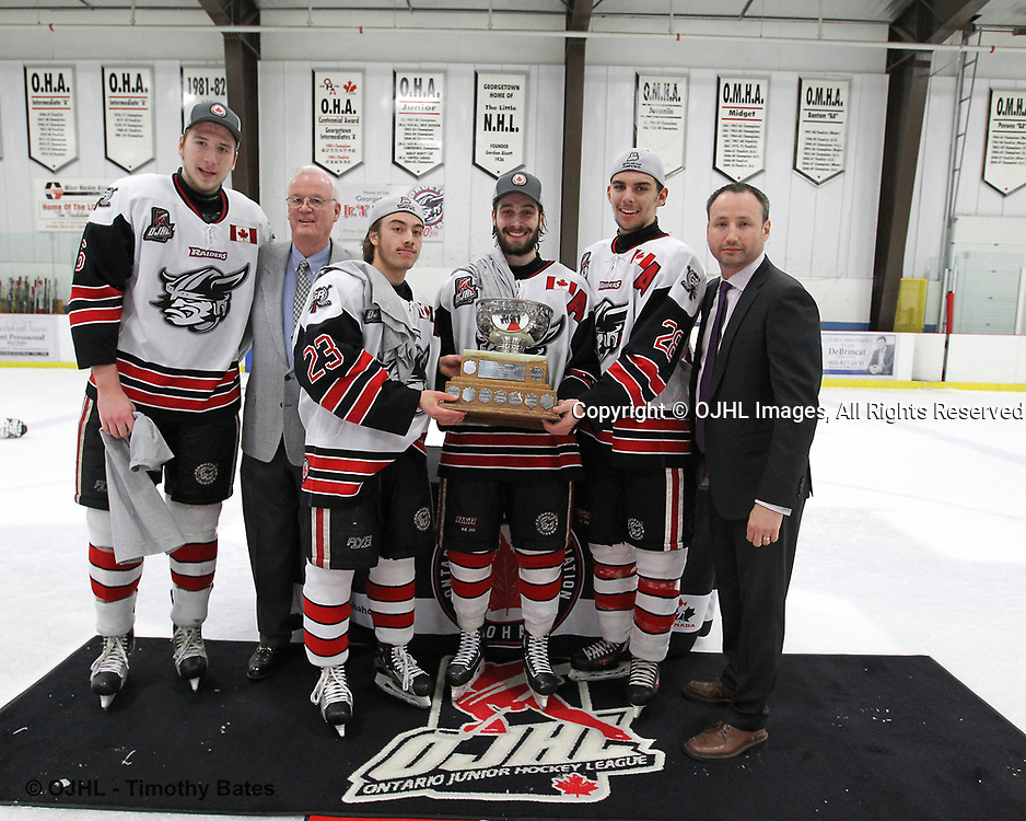 GEORGETOWN, ON  - APR 26,  2017: Ontario Junior Hockey League, Championship Series. Georgetown Raiders vs the Trenton Golden Hawks in Game 7 of the Buckland Cup Final. The presentation of the Buckland Cup to the Assistant Captains Jacob Payette #6, Jack Jacome #23, Andrew Court #88, and Josh Dickinson #28. Presented by OJHL Commissioner Marty Savoy and Gary Moroney from the Ontario Hockey Association.<br /> (Photo by Tim Bates / OJHL Images)