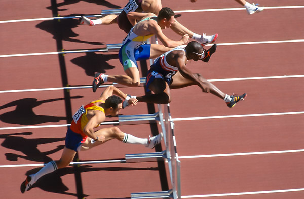 GOTHENBURG -  AUGUST 1995:  Roger Kingdom of the USA (wearing white sunglasses) runs the 110 meter hurdles event of the 1995 IAAF World Championships in Athletics held during August 1995 at Ulevi Stadium in Gothenburg, Sweden. (Photo by David Madison/Getty Images) *** Local Caption *** Roger Kingdom