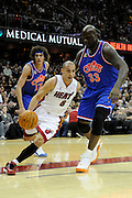 Feb 4, 2010; Cleveland, OH, USA; Miami Heat guard Carlos Arroyo (8) drives around Cleveland Cavaliers forward Anderson Varejao (17) and center Shaquille O'Neal (33) during the second quarter at Quicken Loans Arena. Mandatory Credit: Jason Miller-US PRESSWIRE
