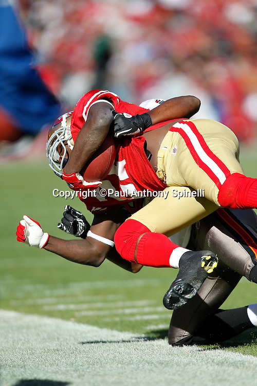 San Francisco 49ers running back Frank Gore (21) dives as he gets tackled near the sideline as he runs the ball during the NFL week 11 football game against the Tampa Bay Buccaneers on Sunday, November 21, 2010 in San Francisco, California. The Bucs won the game 21-0. (©Paul Anthony Spinelli)