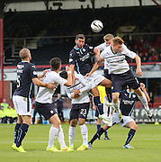 Aerial battle between Dundee's Peter MacDonald and Raith Rovers' Paul Watson and Jason Thomson - Dundee v Raith Rovers, Scottish League Cup at Dens Park<br /> <br />  - &copy; David Young - www.davidyoungphoto.co.uk - email: davidyoungphoto@gmail.com