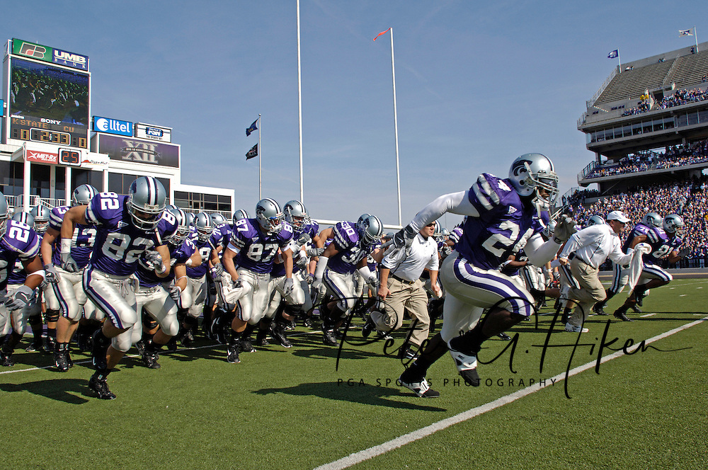 The Kansas State Wildcats rush out onto the field before their game against Colorado at KSU Stadium in Manhattan, Kansas, October 29, 2005.  The Buffaloes beat K-State 23-20.