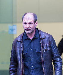 James Matthews, 43, leaves Westminster Magistrates Court where he faces a charge of attending a place used for terrorist training, under the Terrorism Act 2006, after fighting against ISIS with the Kurdish YPG militia. London, February 14 2018.