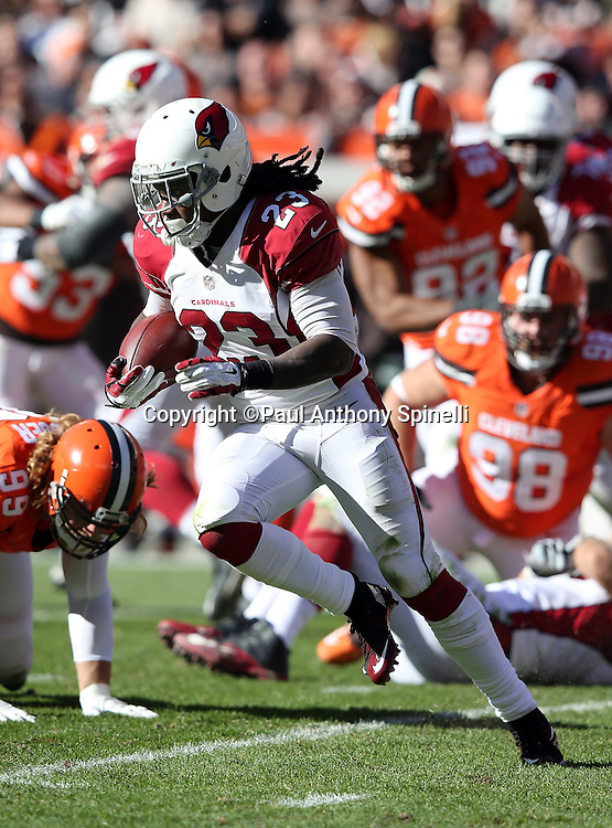 Arizona Cardinals running back Chris Johnson (23) reverses field as he runs for a 5 yard gain in the second quarter during the 2015 week 8 regular season NFL football game against the Cleveland Browns on Sunday, Nov. 1, 2015 in Cleveland. The Cardinals won the game 34-20. (©Paul Anthony Spinelli)