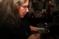 Cathy Nance, former nurse, current chef-blogger at 'The Haunted Chef' and investigator of Woodlands Paranormal, burns ceremonial sage during a house blessing/cleansing in San Antonio. Since the investigations can be sensitive subjects for the clients or businesses involved, the Woodlands Paranormal group, along with most other groups, maintains complete privacy for the clients and will not post any identifying evidence on the internet.