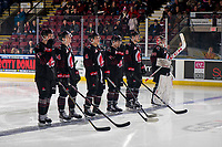 KELOWNA, CANADA - JANUARY 16: Keenan Taphorn #27, Carson Denomie #34, Jett Woo #4, Luke Ormsby #14, Dalton Hamaliuk #6 and Brodan Salmond #30 of the Moose Jaw Warriors  lie up against the Kelowna Rockets on January 16, 2019 at Prospera Place in Kelowna, British Columbia, Canada.  (Photo by Marissa Baecker/Shoot the Breeze)