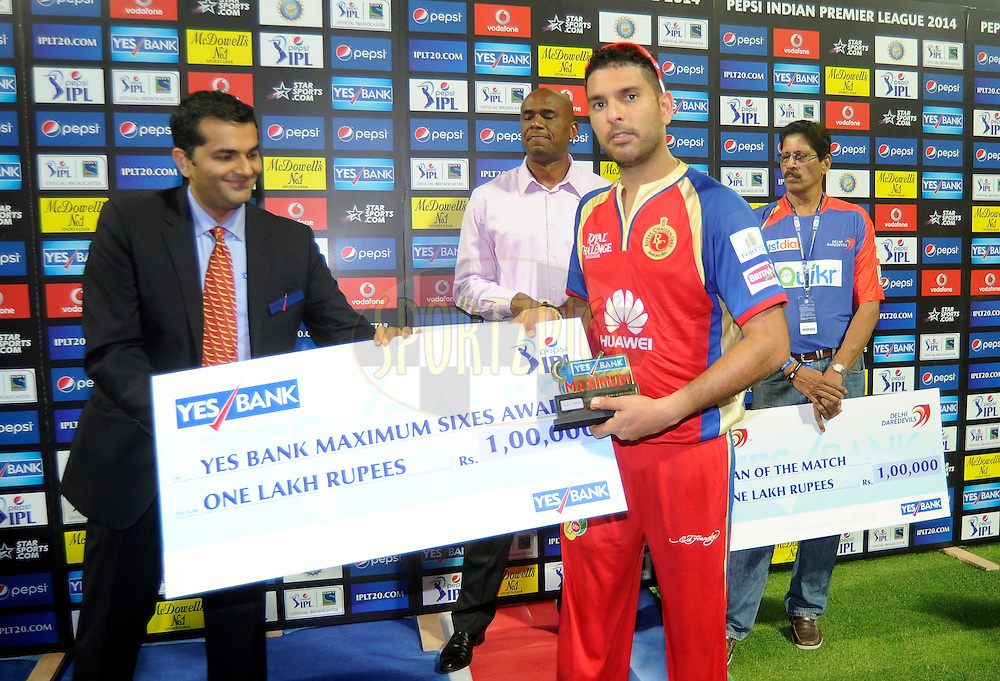 Yuvraj Singh of the Royal Challengers Bangalore receives the Yes bank maximum six award during match 2 of the Pepsi Indian Premier League Season 7 between the Delhi Daredevils and The Royal Challengers Bangalore held at the Sharjah Cricket Stadium, Sharjah, United Arab Emirates on the 17th April 2014<br /> <br /> Photo by Pal Pillai / IPL / SPORTZPICS