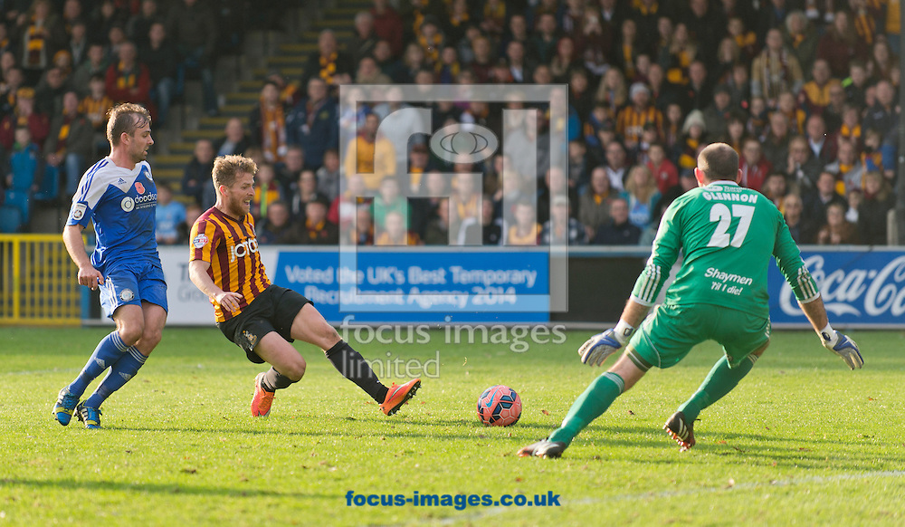 Billy Clarke of Bradford City attempts to slide the ball past FC Halifax Town goalkeeper Matthew Glennon during the The FA Cup match at Shay Stadium, Halifax<br /> Picture by Russell Hart/Focus Images Ltd 07791 688 420<br /> 09/11/2014