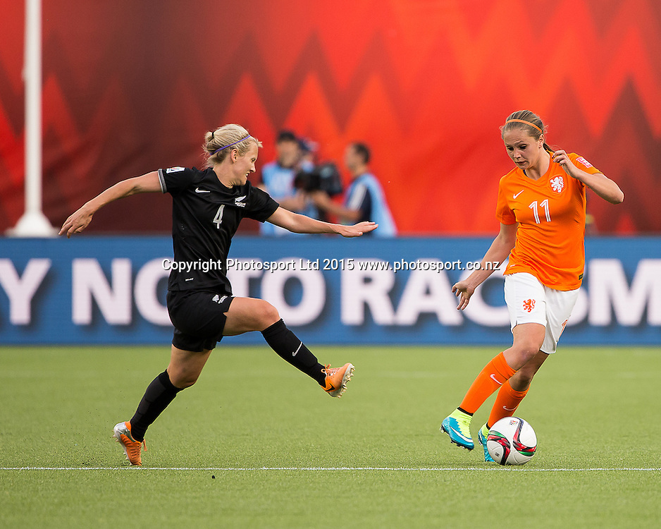 Lieke Martens, Katie Duncan. Edmonton, Alberta, Canada, June 6, 2015.  The opening day of the Women's World Cup at Commonwealth Stadium.  New Zealand was defeated by Netherlands 1-0.