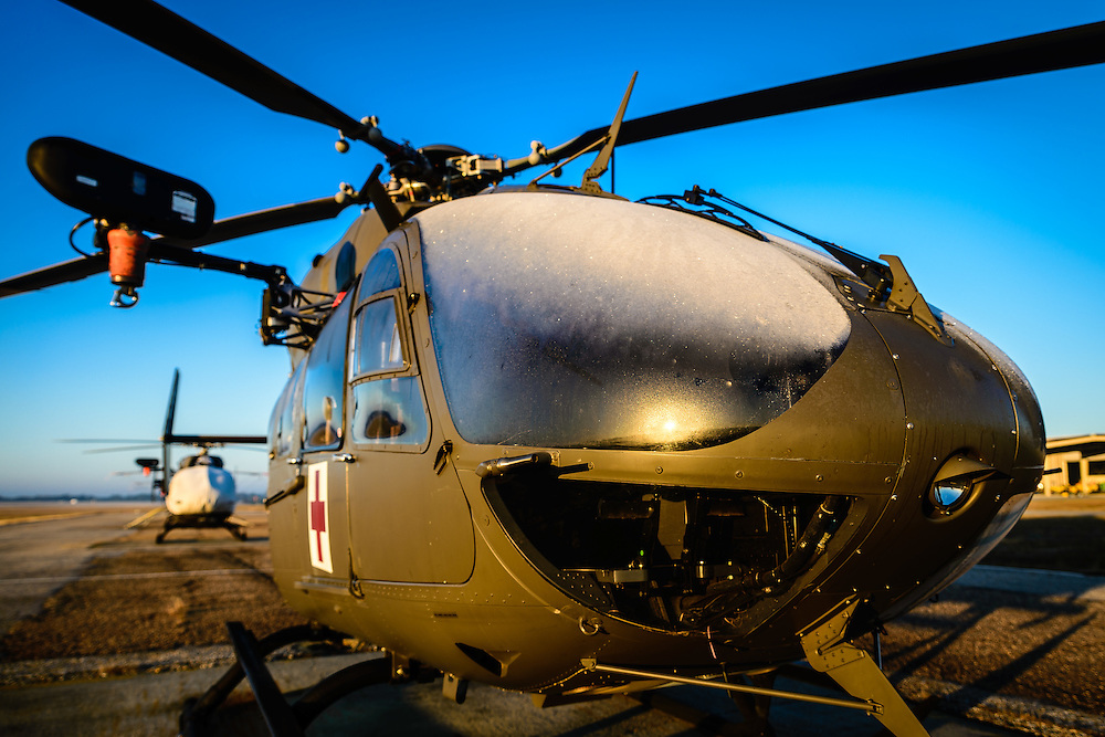 "UH-72 ""Lakota"" MEDEVAC on the flight line during a cold morning sunrise"