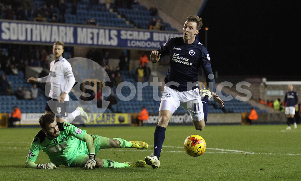 Andy Lonergan of Bolton Wanderers saves from Martyn Woolford of Millwall during the Sky Bet Championship match between Millwall and Bolton Wanderers at The Den, London, England on 19 December 2014. Photo by Edmund  Boyden.