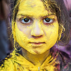 Yellow girl after celebrations of Holi festival, Vrindavan, India