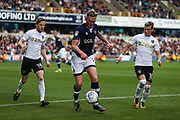 Aiden O'Brien of Millwall (centre) attempts to keep possession of the ball from Eunan O'Kane and Ezgjan Alioski of Leeds United during the EFL Sky Bet Championship match between Millwall and Leeds United at The Den, London, England on 16 September 2017. Photo by Toyin Oshodi.