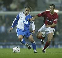 Photo. Aidan Ellis.Digitalsport<br /> Blackburn Rovers v Bournemouth<br /> Carling Cup 2nd round.<br /> 22/09/2004.<br /> Blackburn's Tugay and Bournemouth's Daniel Rodrigues