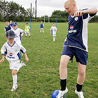 Coach Sean Dobbin holds off David Kirwin at the FAI PEPSI Soccer Camp in Lees Road on Friday.<br /><br /><br /><br /><br /><br />Photograph by Yvonne Vaughan.