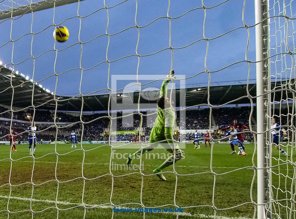 Picture by Andrew Tobin/Focus Images Ltd +44 7710 761829.12/01/2013.Romelu Lukaku of West Brom's shot hits the bar in the 2nd half during the Barclays Premier League match at the Madejski Stadium, Reading.