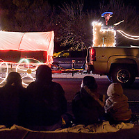 120112       Cable Hoover<br /> <br /> Spectators watch the lighted floats of the Holiday Lights Parade in Grants Satuday.