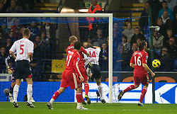BOLTON, ENGLAND - Sunday, October 31, 2010: Bolton Wanderers' Kevin Davies goes down under pressure from Martin Skrtel but no penalty was given during the Premiership match at the Reebok Stadium. (Pic by: David Rawcliffe/Propaganda)