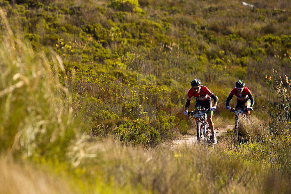 Stage winners David George and Kevin Evans of 360 Life break early up Groenland Berg during stage 6 of the 2012 Absa Cape Epic Mountain Bike stage race held in and around Oak Valley Wine Estate in the Elgin Valley, South Africa on the 31 March 2012..Photo by Sven Martin/Cape Epic/SPORTZPICS