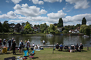 "Maidenhead, United Kingdom. ""Single"" moving past the spectators enclosure. ""Thames Punting Club Regatta"", Bray Reach.<br />