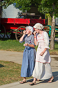 Two Girls in 18th century clothes at the Indianapolis, Indiana, US State Fair