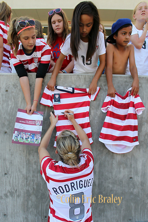 USA's Amy Rodriquez signs autographs after her team's friendly match against Canada, Saturday, June 30, 2012, in Salt Lake City. USA beat Canada 2-1. (AP Photo/Colin E Braley)