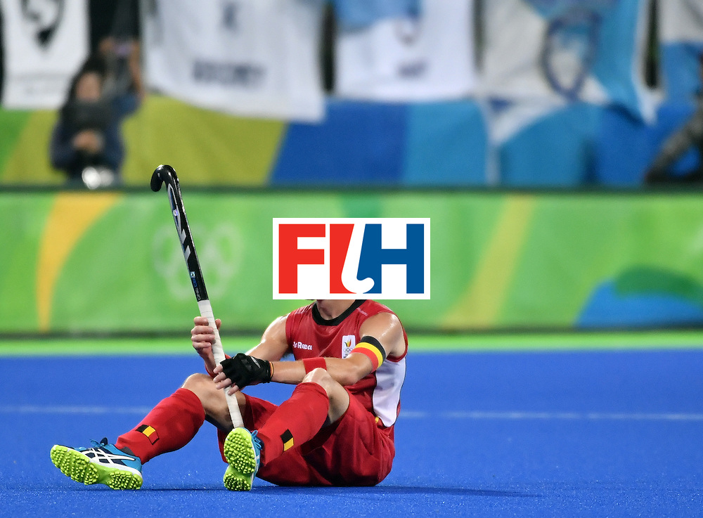 Belgium's John John Dohmen sits on the field at the end of the men's Gold medal field hockey Belgium vs Argentina match of the Rio 2016 Olympics Games at the Olympic Hockey Centre in Rio de Janeiro on August 18, 2016. / AFP / Pascal GUYOT        (Photo credit should read PASCAL GUYOT/AFP/Getty Images)