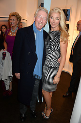 PETER BECKWITH and his daughter TAMARA BECKWITH at a private view of Photographs by Julian Lennon held at The Little Black Gallery, 13A Park Walk, London SW10 on 17th September 2013.