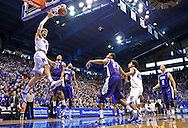 Feb 23, 2013; Lawrence, KS, USA; Kansas Jayhawks center Jeff Withey (5) drives in for a dunk against Texas Christian Horned Frogs forward Adrick McKinney (24) during the first half at Allen Fieldhouse. Kansas defeated Texas Christian 74-48.