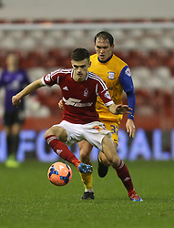 Nottingham Forest's Jamie Paterson protects the ball from Preston North End's Neil Kilkenny - Photo mandatory by-line: Matt Bunn/JMP - Tel: Mobile: 07966 386802 24/01/2014 - SPORT - FOOTBALL - City Ground - Nottingham - Nottingham Forest v Preston North End - FA Cup - Fourth Round