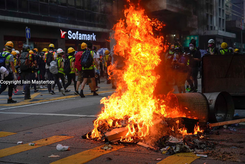 Hong Kong. 1 October 2019. After a peaceful march through Hong Kong Island by an estimated 100,000 pro democracy supporters, violent flared up at Tamar, Admiralty and moved through Wanchai district. Police used teargas and baton rounds and water cannon. Hard core group lit fires, threw bricks and Molotov cocktails at police. Violence continues into evening. Fire set in Wanchai district .Iain Masterton/Alamy Live News.