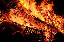 Biggar, South Lanarkshire, Scotland.  The spectacular hogmanay bonfire in the town's High Street was set ablaze at 9.30pm on hogmanay watched by a crowd of several thousand.  It is the biggest hogmanay bonfire in the country and a continuing tradition dating back hundreds of years.  The fire was set alight by local resident Mrs. Dorothy Frame.<br /> <br /> (c) Andrew Wilson | Edinburgh Elite media