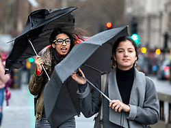 © Licensed to London News Pictures. 10/12/2019. London, UK. Londoners and tourists struggle with their umbrellas in the wind and rain on Westminster Bridge as weather experts predict wind, rain and showers to continue for the General Election on Thursday 12th December 2019. Photo credit: Alex Lentati/LNP