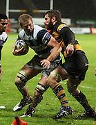 Taranaki number eight Jarrad Hoeata lines up a tackle on Andrew Van der Heijden.<br /> Air New Zealand Cup rugby match - Taranaki v Auckland at Yarrows Stadium, New Plymouth, New Zealand. Friday 9 October 2009. Photo: Dave Lintott/PHOTOSPORT