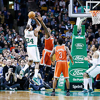 21 December 2012: Boston Celtics small forward Paul Pierce (34) takes a jumpshot over Milwaukee Bucks center Larry Sanders (8) during the Milwaukee Bucks 99-94 overtime victory over the Boston Celtics at the TD Garden, Boston, Massachusetts, USA.