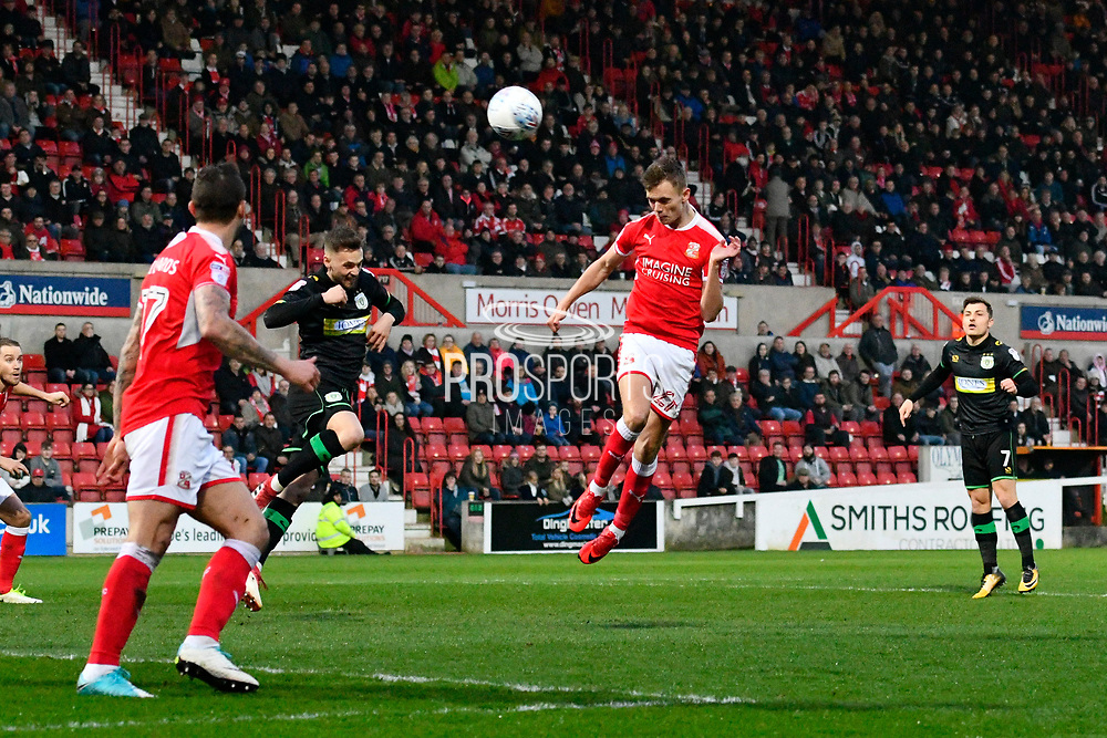 Scott Twine (27) of Swindon Town heads the ball during the EFL Sky Bet League 2 match between Swindon Town and Yeovil Town at the County Ground, Swindon, England on 10 April 2018. Picture by Graham Hunt.
