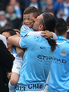Martin De Michelis of Manchester City celebrates winning the  Barclays Premier League with his son at the Etihad Stadium, Manchester<br /> Picture by John Rainford/Focus Images Ltd +44 7506 538356<br /> 11/05/2014