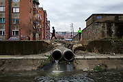 Sewer pipes exits into the Lushta River, running though Mitrovica.