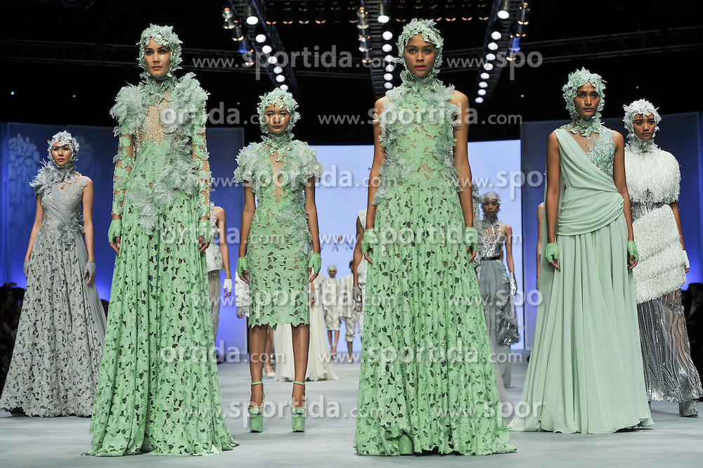 Models present creations by designer Ivan Gunawan during the Indonesian Fashion Week 2015 at Jakarta Convention Center in Jakarta, Indonesia, Feb. 26, 2015. Indonesian Fashion Week 2015 is held from Feb. 26 to March 1. EXPA Pictures &copy; 2015, PhotoCredit: EXPA/ Photoshot/ Veri Sanovri<br /> <br /> *****ATTENTION - for AUT, SLO, CRO, SRB, BIH, MAZ only*****