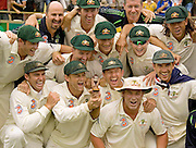 Captain Ricky Ponting holds a replica of the Ashes urn as his team celebrate winning the third Test Match and the series between Australia and England at the WACA in Perth. Photograph © Graham Morris/cricketpix.com (Tel: +44 (0)20 8969 4192; Email: sales@cricketpix.com) Ref. No. 06598g27