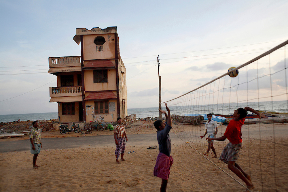 Kids playing volleyball outside the church of Manakudi. Most of the houses lining the beach were destroyed in the tsunami. The houses functioned as a wall protecting the church that was unharmed by the waves.